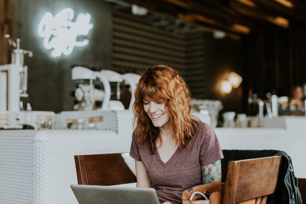 woman smiling at online ecommerce business office