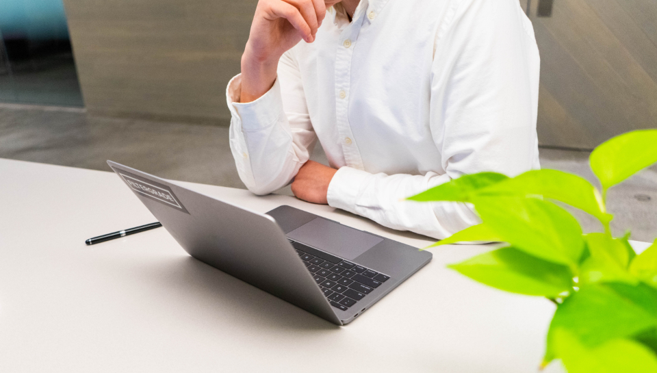 person on laptop planning online inventory sourcing