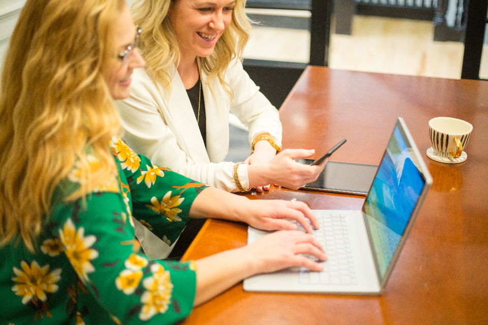 two woman working on their ecommerce website
