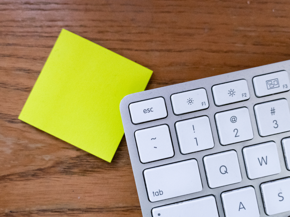 post it notes and keyboard at online company